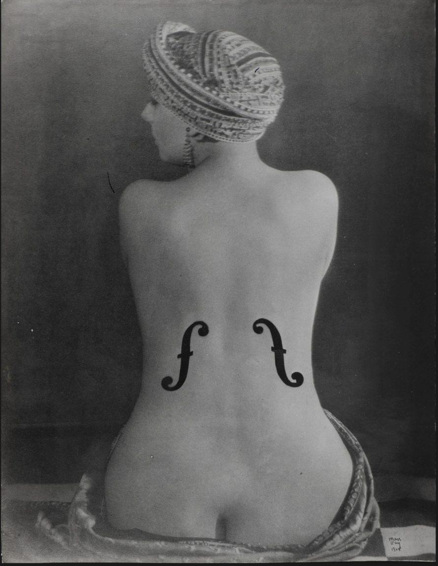 <b>MAN RAY (1890-1976)</b><br> <i>Le Violon d'Ingres, 1924</i><br> gelatin silver print, printed in 1950s<br> image: 5 ¾ x 4 ¼ in. <br> sheet: 5 ¾ x 4 3/8 in. <br> <b>Estimate:</b> $200,000-300,000