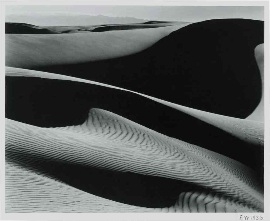 Fotó: Edward Weston<br> <b>'Dunes, Oceano'</b><br> gelatin silver print, mounted, initialed and dated in pencil on the mount, signed, titled, and dated in pencil on the reverse, 1936, probably printed in the 1940s<br> image: 7 ½ by 9 ½ in. (19.1 by 24.1 cm.)<br> frame: 13 ½ by 15 ¼ in. (34.3 by 34.4 cm.)<br> Estimate $60/80,000