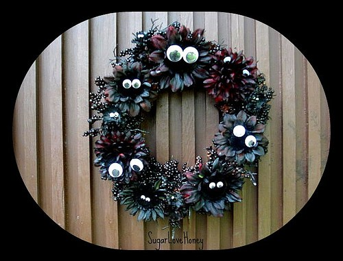 Here is some Halloween craft inspiration for you. Googly eyes! In your Halloween wreath! Ever feel like somebody is watching you?