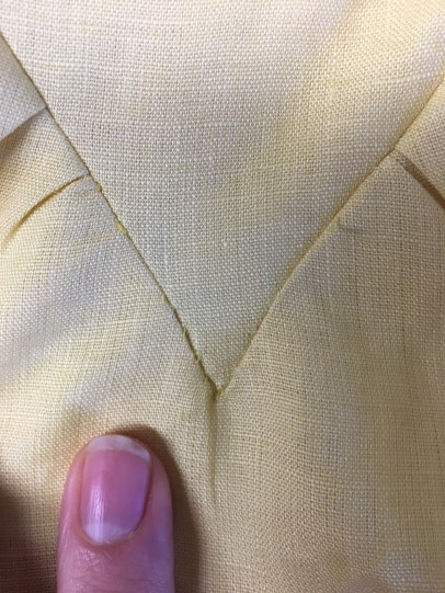 Hand-stitching point into place