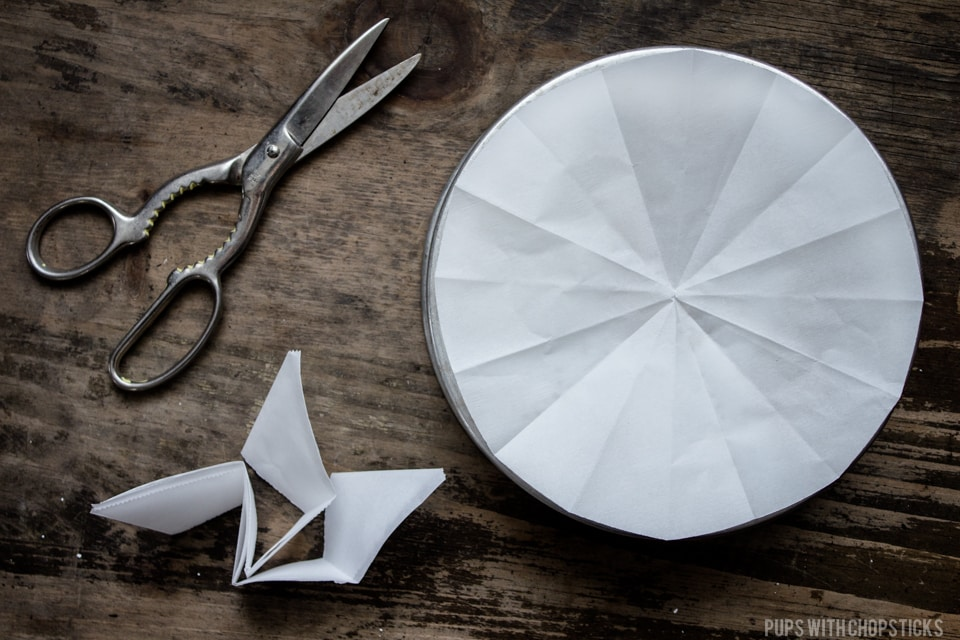Cutting a parchment paper to line a pan