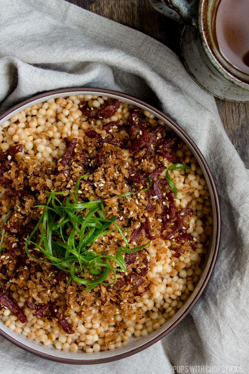 An deliciously nutty and flavourful israeli couscous recipe with a bit of a chew, generously topped with crispy garlic anchovy bread crumbs. Works great as a quick and easy side dish or a one bowl meal! #couscous #sidedish #recipe #salad #crispy