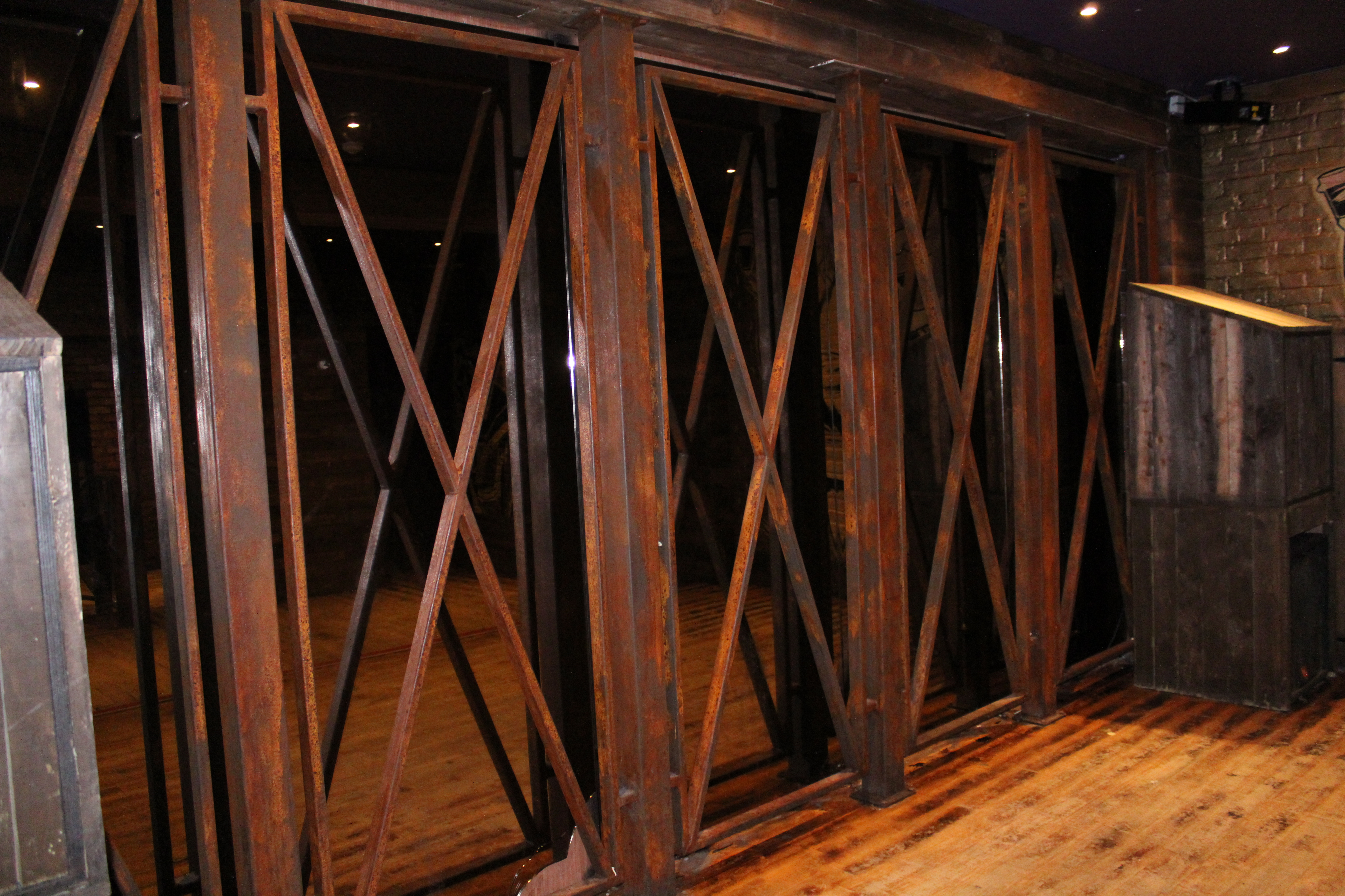 Painted Rust Effect Mild Steel Frame in Front of Mirror at Stage Area (2)