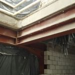 13 - Concrete cutout complete as steel supports the precast floor