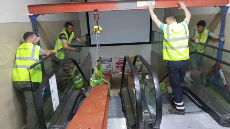 5 - Steel being lowered down escalator