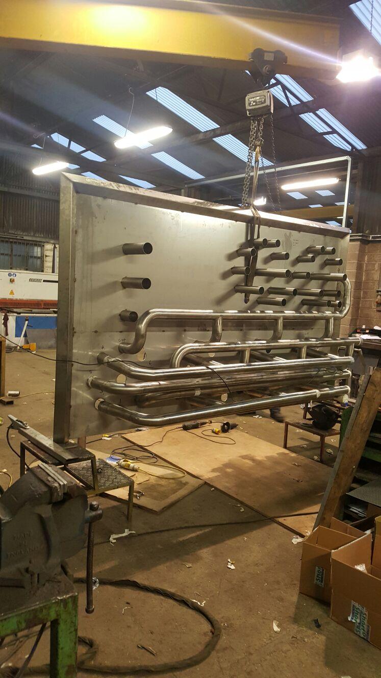 Flow plate pipe work