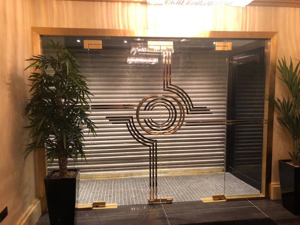 Door-after-installation-of-glass-brass-framed-doors