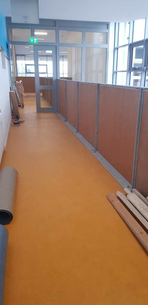 Installation of feature stair case in a school (7) with temporary screen placed while awaiting glass