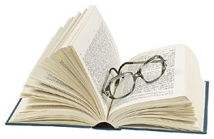 book with glasses