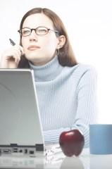 Woman sitting at computer