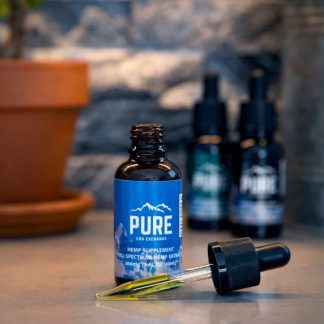 A CBD tincture with the tincture dropper sitting in front of it