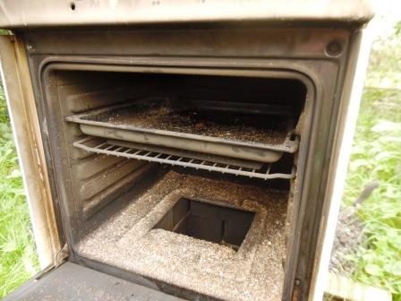 1 a recycled oven, now transformed into a woodburned