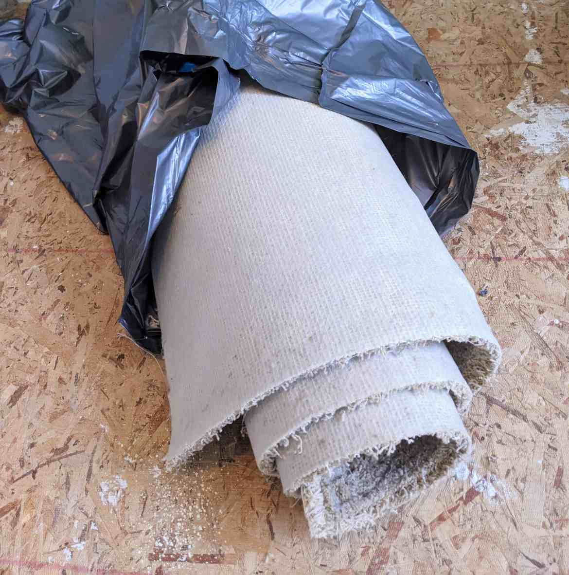rolled up old carpeting