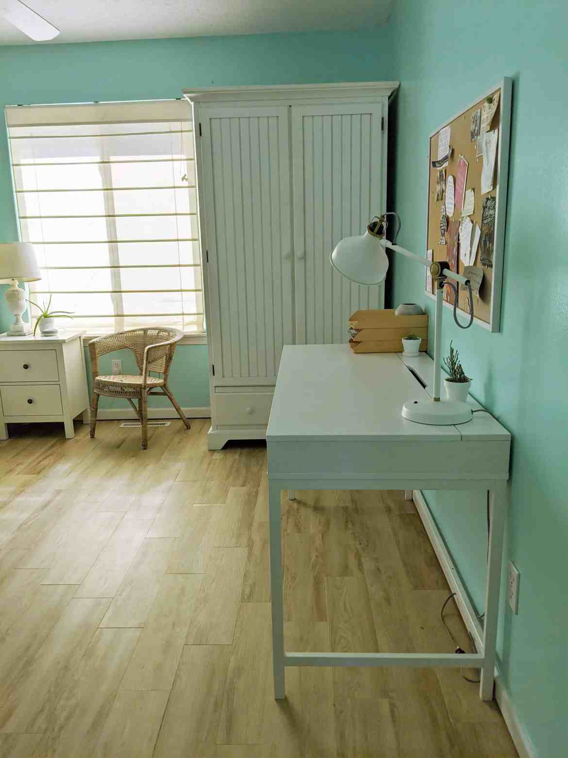 blue girls room with white furniture