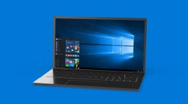 Windows 10 laptop with blue background
