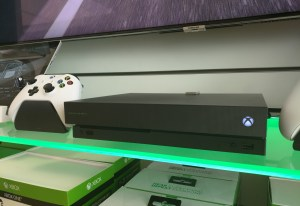Xbox One X with controller on Microsoft Store shelve