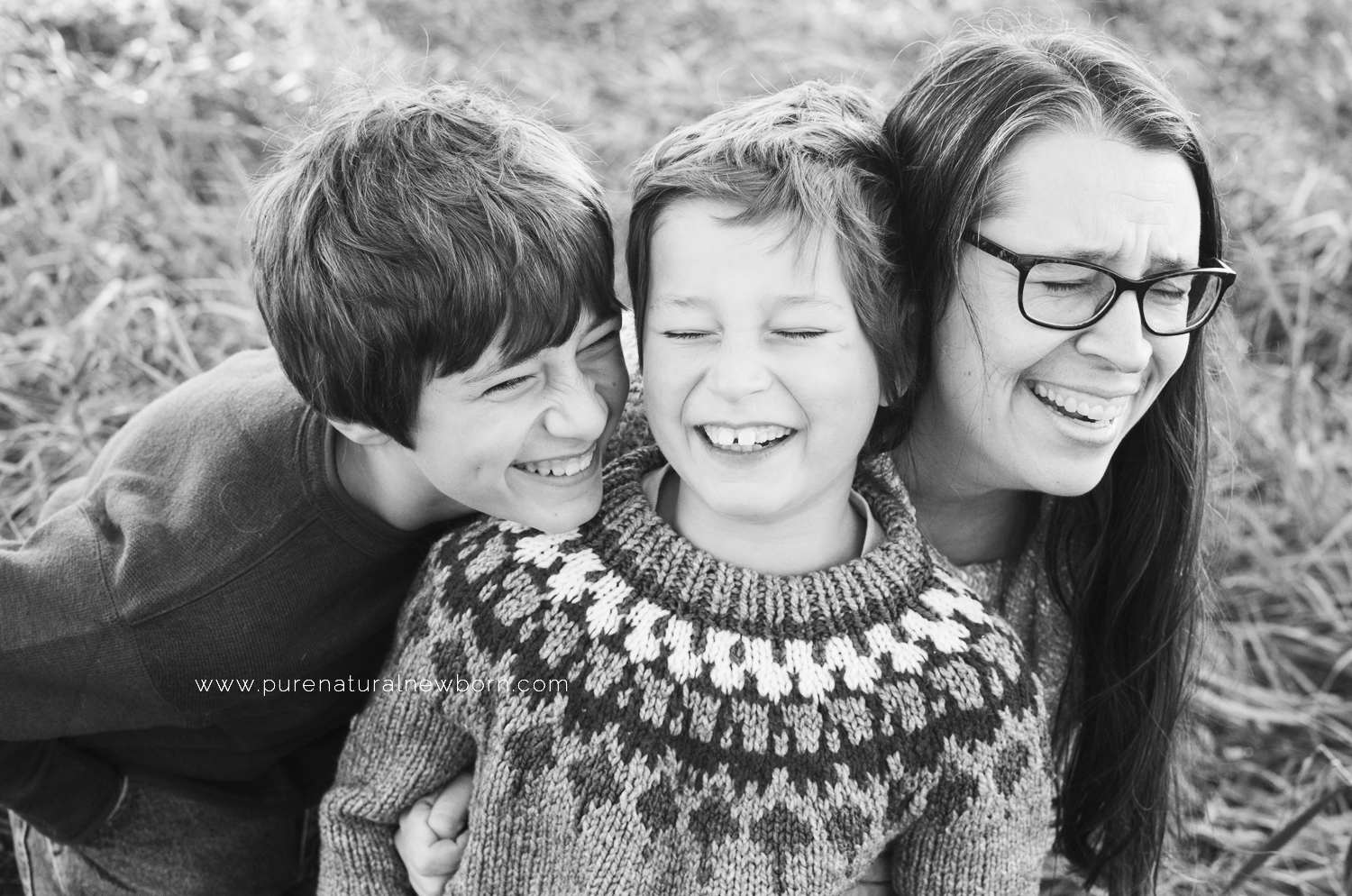 Debora Rodrigues Family Photos Ottawa Photographer Babywearing in Canada Black And White Family Portrait