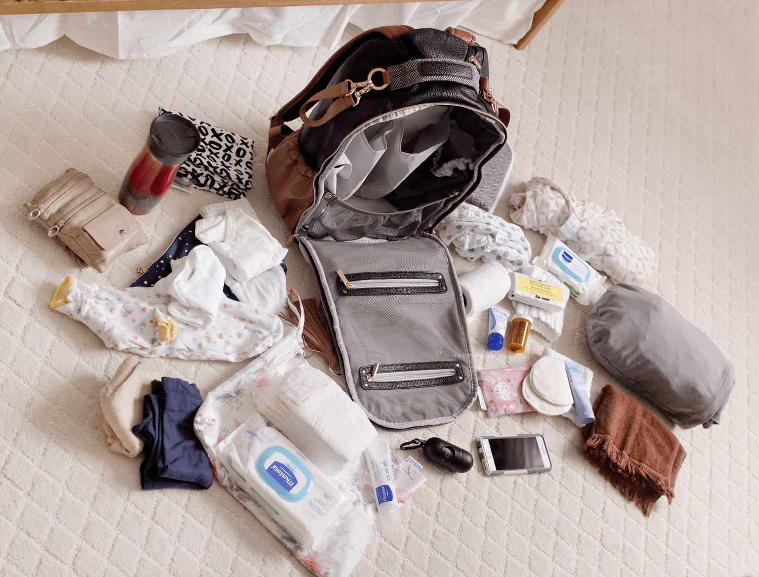 itzy ritzy boss backpack coffee & cream what's in diaper bag contents reveal layflat