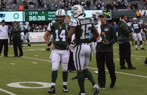 (Credit: Barry Holmes/PureSportsNY) Ryan Fitzpatrick and Brandon Marshall talking during pre-game warm-ups.