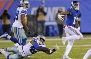New York Giants' Odell Beckham (13) runs past Dallas Cowboys' Barry Church (42) for a touchdown during the second half of an NFL football game Sunday, Dec. 11, 2016, in East Rutherford, N.J. (AP Photo/Bill Kostroun)