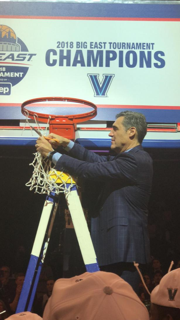 Jay Wright cutting the net after winning the Big East Crown.
