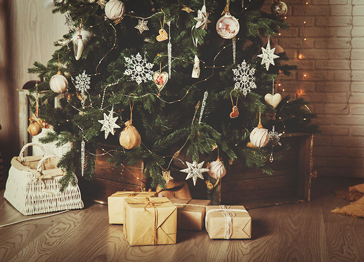Christmas tree and presents in decorated living room