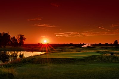 Sunset over the short game practice area - Purgatory Golf Club