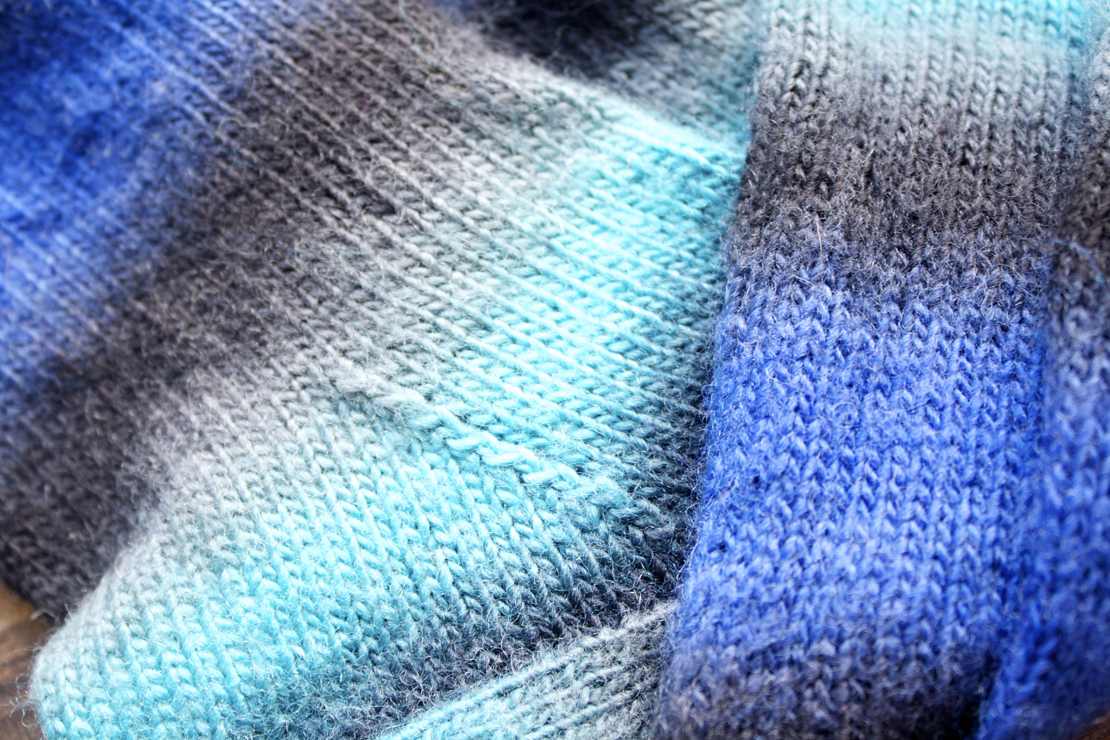 The colours are wonderful.  The greys make the aqua and blue really pop!
