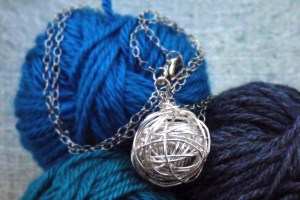 Handmade silver yarn necklace, pendant on a long chain.