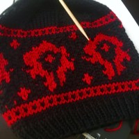 WoW Horde Symbol Knit Hat. Free knitting chart from PurlsAndPixels.