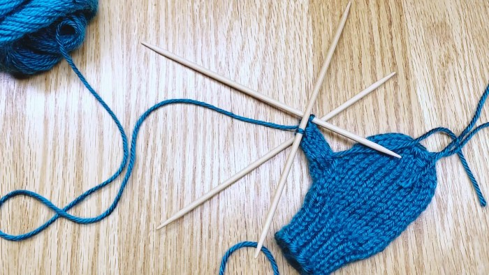 Learn to knit glove thumbs off stitch holders with double point needles (DPNs) in this knitting lesson with Liz Chandler @PurlsAndPixels.
