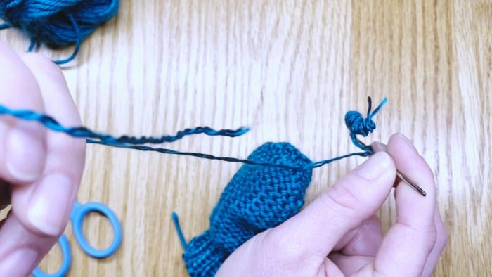 Step 15: Weave in the yarn tail to finish mitten fingertips a knitting lesson with Liz Chandler @PurlsAndPixels.
