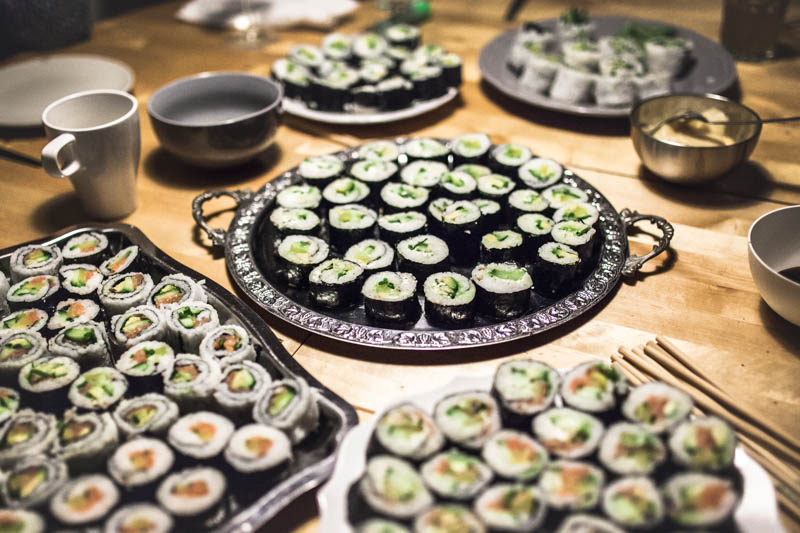 How to host a sushi party - Several huge platters with different kinds of sushi