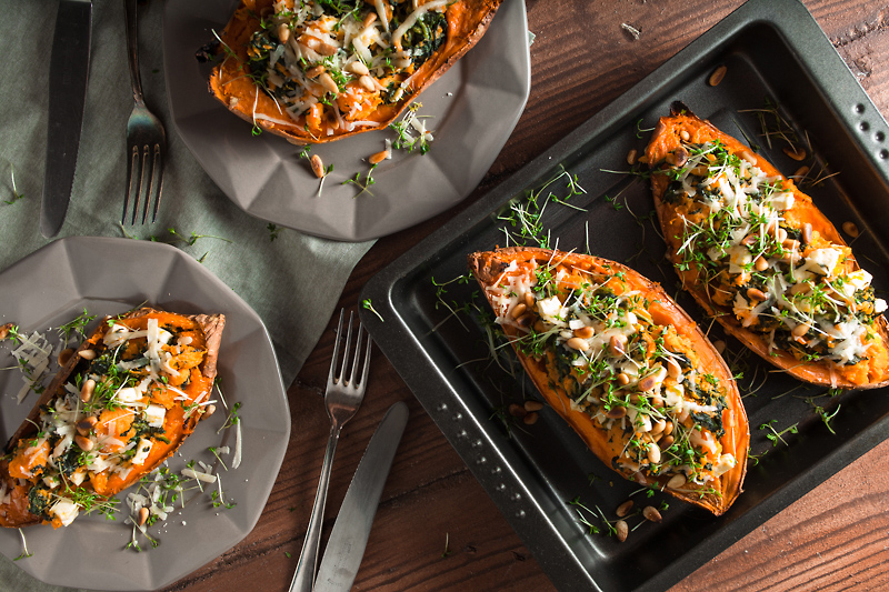 Recipe for stuffed sweet potato with spinach, feta cheese, parmesan and pine seeds. Comforting, simple and delicious!