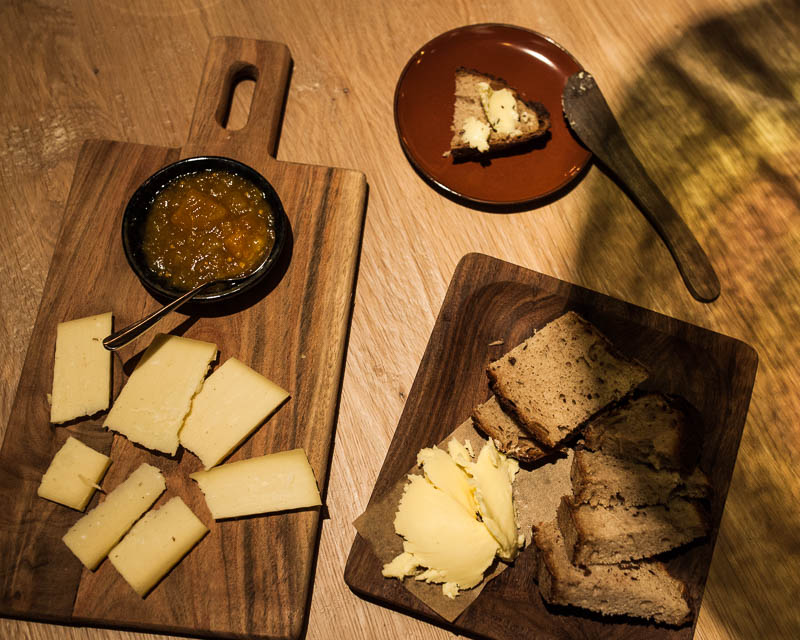 15 month aged cheese from the Allgäu with homemade bread and butter. Hygge - Restaurant Guide Hamburg