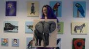 "Me holding my ""African Elephant"" 3D ACrylic Painting in my studio in front of some of my other 3D Acrylic Paintings"