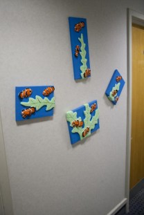 """Clownfish"" 3D Acrylic Paintings by Purple Faye up in the corridor outside my studio"