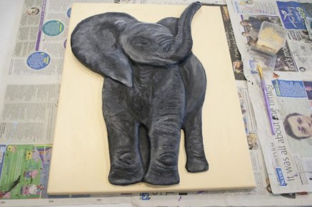 "Painting the background on the ""Baby African Elephant"" 3D Acrylic Painting. I chose a light sandy colour to contrast with the dark of the elephant and to suggest the colour of the landscape."