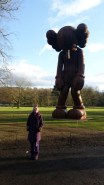 Me (Purple Faye) stood in front of SMALL LIE (2013). Wood, 1000 x 464 x 427cm KAWS
