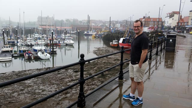 Boyfriend in shorts and T-shirt at Scarborough Harbour