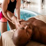 Purple Freesia Blog image - lady giving massage