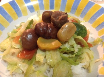 Brussel Sprouts & tomato stir-fried with garlic, topped with chestnuts.