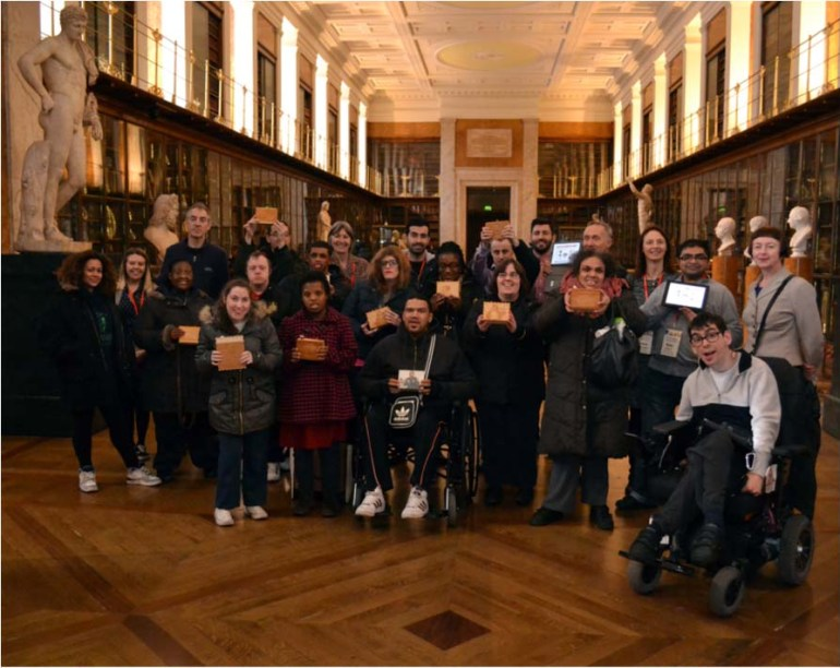 Large group of purpleSTARS posing with their Sensory Labels in the Enlightenment Gallery at the British Museum.