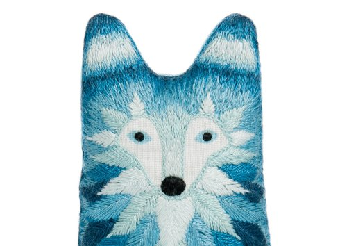 Still life photo of a wolf plush toy, frontal view.