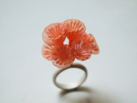 Still life photo of a ring realised with semi transparent and translucent textiles, the shape reminds natural and organic forms taken from nature.