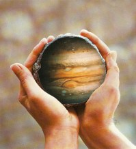 Closeup of two hands holding a planet.