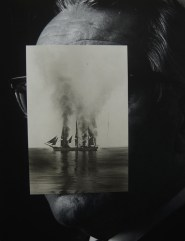Man portrait with the face covered by a paper cut of a boat.
