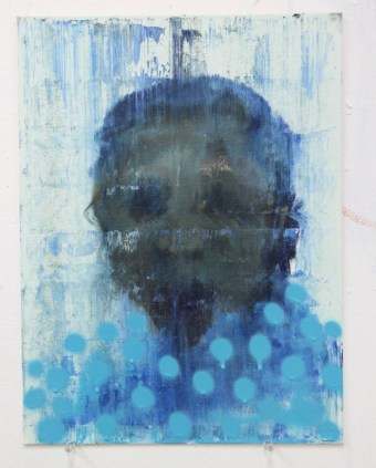 Blue defaced portrait painting.