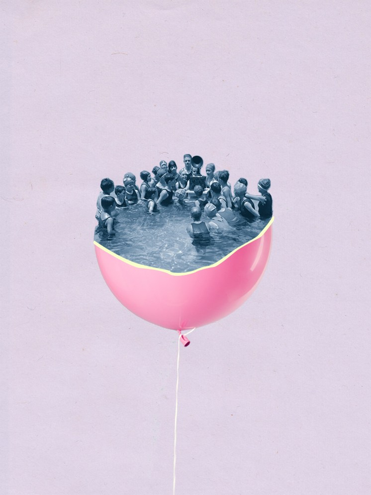 Group of people in a pool inside a floating pink balloon.
