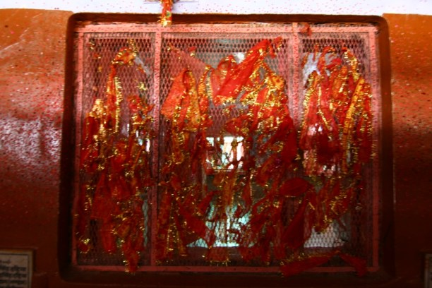 The prayer threads tied to the temple window